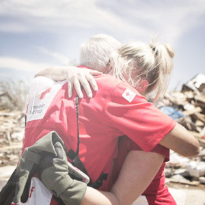 a volunteer hugging a disaster victim